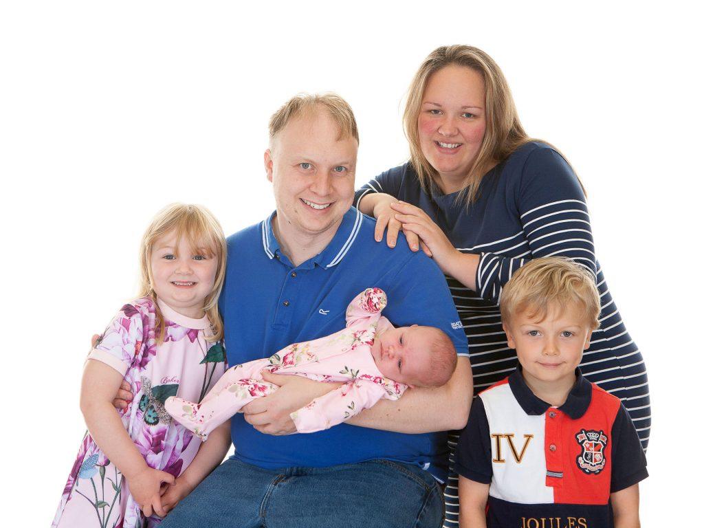 mom, dad, their eldest son, daughter and newborn baby