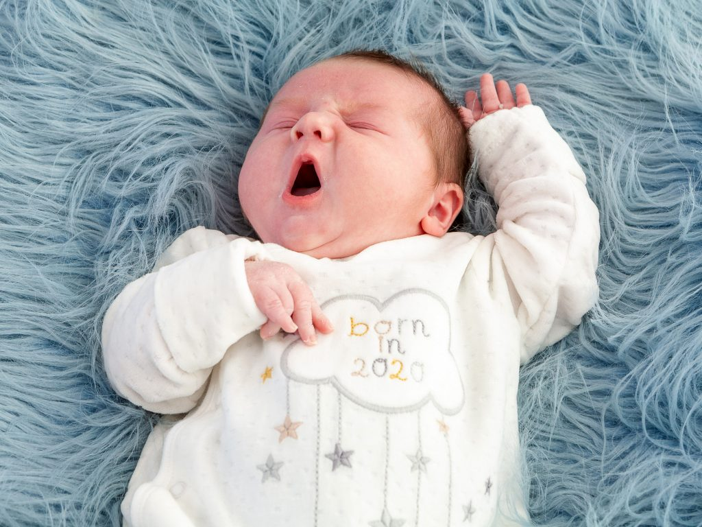 little baby born in 2020 yawning
