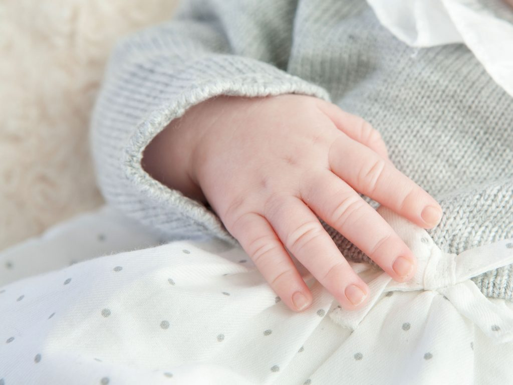 close up of a newborn baby's hand