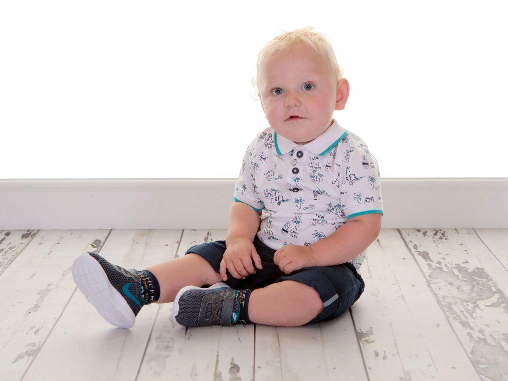 Little boy toddler wearing Nike trainers